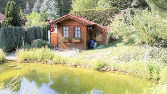 Idyllisches Haus mit Teich als Geldanlage und Mieteinnahmen!